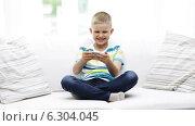 Купить «Smiling boy playing with smartphone at home», видеоролик № 6304045, снято 12 июня 2014 г. (c) Syda Productions / Фотобанк Лори