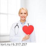 Купить «smiling female doctor with heart and stethoscope», фото № 6317257, снято 15 апреля 2014 г. (c) Syda Productions / Фотобанк Лори