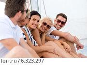 Купить «smiling friends sitting on yacht deck», фото № 6323297, снято 13 июля 2014 г. (c) Syda Productions / Фотобанк Лори