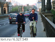 Купить «Two men on bicycles, Warsaw, Poland», фото № 6327549, снято 29 апреля 2004 г. (c) Caro Photoagency / Фотобанк Лори