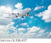 Купить «Airplane in the blue sky.», фото № 6336417, снято 19 ноября 2017 г. (c) Maksym Yemelyanov / Фотобанк Лори