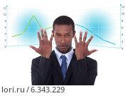 Купить «Businessman with a graph», фото № 6343229, снято 19 июля 2019 г. (c) Phovoir Images / Фотобанк Лори