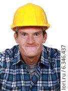 Купить «Tradesman making a face», фото № 6346437, снято 12 мая 2011 г. (c) Phovoir Images / Фотобанк Лори