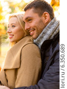 Купить «smiling couple hugging in autumn park», фото № 6350689, снято 5 октября 2013 г. (c) Syda Productions / Фотобанк Лори