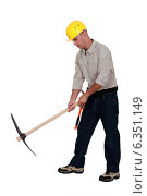 Купить «Laborer using a pickaxe», фото № 6351149, снято 25 мая 2011 г. (c) Phovoir Images / Фотобанк Лори