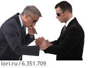 Купить «Mobster helping his boss», фото № 6351709, снято 2 мая 2011 г. (c) Phovoir Images / Фотобанк Лори