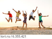 Купить «smiling friends dancing and jumping on beach», фото № 6355421, снято 3 августа 2014 г. (c) Syda Productions / Фотобанк Лори