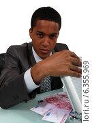 Купить «A crooked businessman», фото № 6355969, снято 19 мая 2011 г. (c) Phovoir Images / Фотобанк Лори