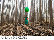 Купить «Beautiful blonde girl, dressed in green, walking into the forest», фото № 6372093, снято 20 июня 2019 г. (c) Ingram Publishing / Фотобанк Лори