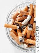 Купить «Overhead view of glass ashtray full of cigarette stubs», фото № 6372193, снято 12 декабря 2018 г. (c) Ingram Publishing / Фотобанк Лори