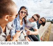 Купить «group of teenagers hanging out», фото № 6380185, снято 20 июля 2013 г. (c) Syda Productions / Фотобанк Лори