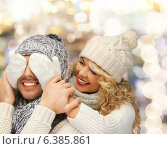 Купить «smiling couple in sweaters and santa helper hats», фото № 6385861, снято 7 октября 2012 г. (c) Syda Productions / Фотобанк Лори
