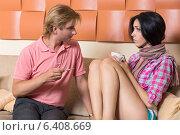 Купить «Мужчина с градустником сидит возле заболевшей женщины», фото № 6408669, снято 8 августа 2014 г. (c) Okssi / Фотобанк Лори