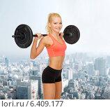 Купить «smiling sporty woman exercising with barbell», фото № 6409177, снято 8 мая 2014 г. (c) Syda Productions / Фотобанк Лори