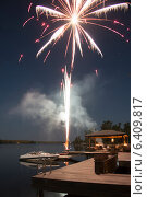 Купить «Firework display over a lake, Kenora, Lake of The Woods, Ontario, Canada», фото № 6409817, снято 29 сентября 2012 г. (c) Ingram Publishing / Фотобанк Лори