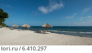 Купить «Sunshades with chairs on the beach, Utopia Village, Utila, Bay Islands, Honduras», фото № 6410297, снято 28 декабря 2012 г. (c) Ingram Publishing / Фотобанк Лори