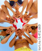 Купить «smiling friends in circle on summer beach», фото № 6412669, снято 3 августа 2014 г. (c) Syda Productions / Фотобанк Лори