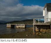 Купить «Stilt house on coastline, Norris Point, Newfoundland And Labrador, Canada», фото № 6413645, снято 29 августа 2013 г. (c) Ingram Publishing / Фотобанк Лори