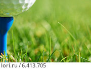 Купить «Close-up of golf ball resting on blue tee with grass and space for copy», фото № 6413705, снято 13 марта 2014 г. (c) Ingram Publishing / Фотобанк Лори