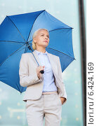 Купить «young serious businesswoman with umbrella outdoors», фото № 6424169, снято 19 августа 2014 г. (c) Syda Productions / Фотобанк Лори