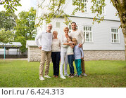 Купить «happy family in front of house outdoors», фото № 6424313, снято 21 августа 2014 г. (c) Syda Productions / Фотобанк Лори