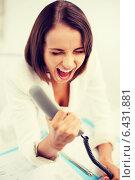 Купить «woman shouting into phone in office», фото № 6431881, снято 18 июля 2013 г. (c) Syda Productions / Фотобанк Лори