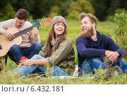 Купить «group of smiling friends with guitar outdoors», фото № 6432181, снято 31 августа 2014 г. (c) Syda Productions / Фотобанк Лори