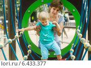 Купить «Little girl with mother at action-oriented playground», фото № 6433377, снято 6 июля 2014 г. (c) Яков Филимонов / Фотобанк Лори
