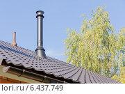 Купить «Современный дымоход и вентиляция на крыше», эксклюзивное фото № 6437749, снято 20 сентября 2014 г. (c) Юрий Шурчков / Фотобанк Лори