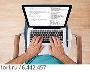 Купить «Man Using Laptop At Home», фото № 6442457, снято 22 марта 2014 г. (c) Андрей Попов / Фотобанк Лори