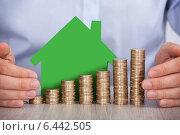 Купить «Hands Protecting Stacked Euro Coins And House Model», фото № 6442505, снято 22 марта 2014 г. (c) Андрей Попов / Фотобанк Лори