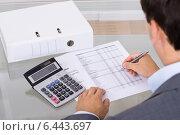 Купить «Accountant calculating finances», фото № 6443697, снято 16 июля 2014 г. (c) Андрей Попов / Фотобанк Лори