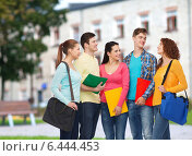 Купить «group of smiling teenagers», фото № 6444453, снято 22 июня 2014 г. (c) Syda Productions / Фотобанк Лори