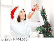 Купить «woman in santa helper hat with christmas ball», фото № 6444565, снято 15 августа 2013 г. (c) Syda Productions / Фотобанк Лори