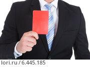 Купить «Businessman Showing Red Card», фото № 6445185, снято 11 мая 2014 г. (c) Андрей Попов / Фотобанк Лори