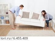Купить «Happy Couple Placing Sofa In Living Room», фото № 6455409, снято 12 июня 2014 г. (c) Андрей Попов / Фотобанк Лори