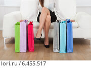 Купить «Woman With Multicolored Shopping Bags At Home», фото № 6455517, снято 12 июня 2014 г. (c) Андрей Попов / Фотобанк Лори