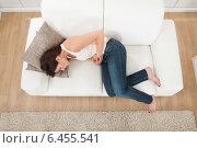 Купить «Woman Suffering From Stomachache On Sofa», фото № 6455541, снято 12 июня 2014 г. (c) Андрей Попов / Фотобанк Лори