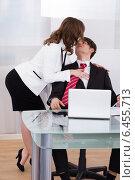 Купить «Sensuous Secretary Seducing Businessman At Desk», фото № 6455713, снято 23 февраля 2014 г. (c) Андрей Попов / Фотобанк Лори