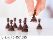Купить «Woman's Hand Holding Chess Pawn», фото № 6457585, снято 31 мая 2014 г. (c) Андрей Попов / Фотобанк Лори