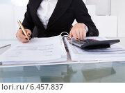 Купить «Accountant Calculating Tax», фото № 6457837, снято 15 марта 2014 г. (c) Андрей Попов / Фотобанк Лори