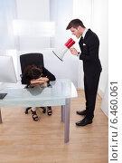 Купить «Businessman Shouting Through Megaphone On Businesswoman», фото № 6460061, снято 9 марта 2014 г. (c) Андрей Попов / Фотобанк Лори