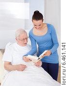 Купить «Caretaker And Senior Man Reading Book», фото № 6461141, снято 15 марта 2014 г. (c) Андрей Попов / Фотобанк Лори