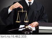 Judge Holding Weight Scale At Desk. Стоковое фото, фотограф Андрей Попов / Фотобанк Лори