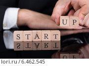 Купить «Businessman Arranging Startup Blocks On Desk», фото № 6462545, снято 28 июня 2014 г. (c) Андрей Попов / Фотобанк Лори