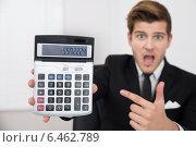 Купить «Shocked Businessman Looking At Calculator», фото № 6462789, снято 28 июня 2014 г. (c) Андрей Попов / Фотобанк Лори