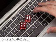 Купить «Red Game Dices On Laptop», фото № 6462825, снято 28 июня 2014 г. (c) Андрей Попов / Фотобанк Лори