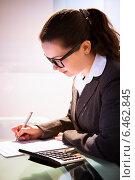 Купить «Businesswoman Calculating Tax», фото № 6462845, снято 23 января 2014 г. (c) Андрей Попов / Фотобанк Лори