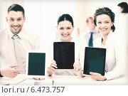 Купить «business team showing tablet pcs in office», фото № 6473757, снято 9 июня 2013 г. (c) Syda Productions / Фотобанк Лори