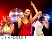 Купить «three smiling women dancing and singing karaoke», фото № 6479349, снято 20 октября 2013 г. (c) Syda Productions / Фотобанк Лори